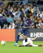 PSG's Neymar, left, challenges for the ball with Marseille's Florian Thauvin, during the League One soccer match between Marseille and Paris Saint-Germain, at the Velodrome stadium, in Marseille, southern France, Sunday, Oct. 22, 2017. (AP Photo/Claude Paris)
