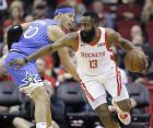 Houston Rockets guard James Harden (13) dribbles around Orlando Magic forward Aaron Gordon during the first half of an NBA basketball game, Sunday, Jan. 27, 2019, in Houston. (AP Photo/Eric Christian Smith)