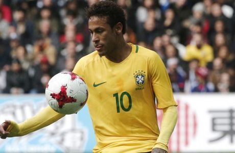 Brazil's Neymar controls the ball during their international friendly soccer match Brazil against Japan at the Pierre Mauroy stadium in Lille, northern France, Friday, Nov. 10, 2017. (AP Photo/Michel Spingler)