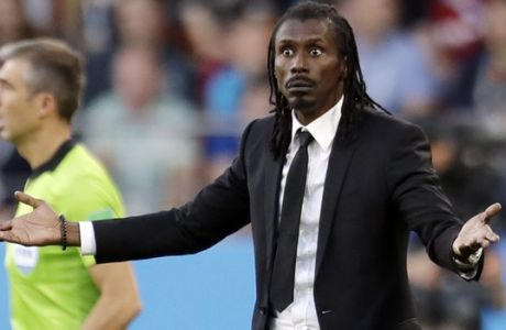 Senegal coach Aliou Cisse follows the game during the group H match between Japan and Senegal at the 2018 soccer World Cup at the Yekaterinburg Arena in Yekaterinburg , Russia, Sunday, June 24, 2018. (AP Photo/Natacha Pisarenko)