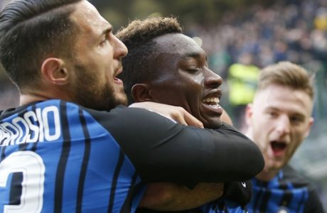 Inter Milan's Yann Karamoh, center, celebrates with his teammates after scoring his side's second goal during the Serie A soccer match between Inter Milan and Bologna at the San Siro stadium in Milan, Italy, Sunday, Feb. 11, 2018. (AP Photo/Antonio Calanni)