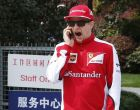 Ferrari driver Kimi Raikkonen of Finland yawns while talking on a smartphone upon arrival at the paddock of Shanghai International Circuit in Shanghai, China, Thursday, April 9, 2015 ahead of Sunday's Chinese Formula One Grand Prix. (AP Photo/Toru Takahashi)