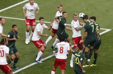 Australia's Mathew Leckie heads the ball during the group C match between Denmark and Australia at the 2018 soccer World Cup in the Samara Arena in Samara, Russia, Thursday, June 21, 2018. (AP Photo/Efrem Lukatsky)
