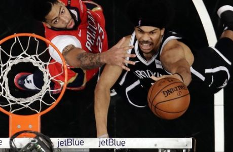 New Orleans Pelicans' Anthony Davis (23) defends against Brooklyn Nets' Jarrett Allen (31) during the second half of an NBA basketball game Wednesday, Jan. 2, 2019, in New York. The Nets won 126-121. (AP Photo/Frank Franklin II)