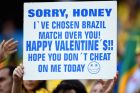SAO PAULO, BRAZIL - JUNE 12: A fan holds up a sign before the Opening Ceremony of the 2014 FIFA World Cup Brazil prior to the Group A match between Brazil and Croatia at Arena de Sao Paulo on June 12, 2014 in Sao Paulo, Brazil.  (Photo by Christopher Lee/Getty Images)