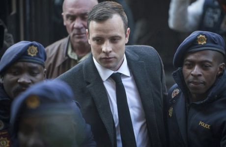 FILE - In this July 6, 2016, file photo, Oscar Pistorius, center, arrives at the High Court in Pretoria, South Africa, for a sentencing hearing for the murder of his girlfriend Reeva Steenkamp in his home on Valentine's Day 2013. The State is again challenging a ruling by Judge Thokozile Masipa against Pistorius in the High Court in Johannesburg, Friday, Aug. 26, 2016. (AP Photo/Shiraaz Mohamed, File)
