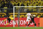 Dortmund's Matthias Ginter, left, scores an own goal during the Champions League quarterfinal first leg soccer match between Borussia Dortmund and AS Monaco in Dortmund, Germany, Wednesday, April 12, 2017. (AP Photo/Martin Meissner)