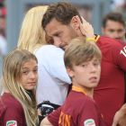AS Roma's captain Francesco Totti embraced by his wife Ilary Blasi with the sons Chanel and Cristian at the end of his last soccer match between AS Roma and Genoa at Olimpico Stadium in Rome, 28 May 2017. ANSA/CLAUDIO PERI