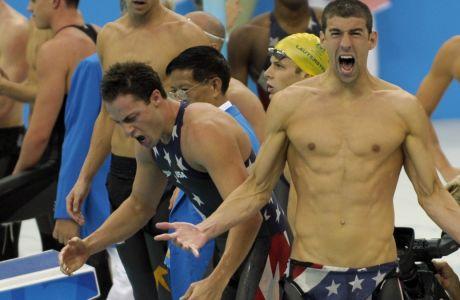 Ο Μάικλ Φελπς πανηγυρίζει έξαλλα τον τερματισμό του Τζέσον Λίζακ για την ομάδα σκυταλοδρομίας των ΗΠΑ στα 4Χ100μ. ελεύθερο των Ολυμπιακών Αγώνων 2008, Πεκίνο, Δευτέρα 11 Αυγούστου 2008