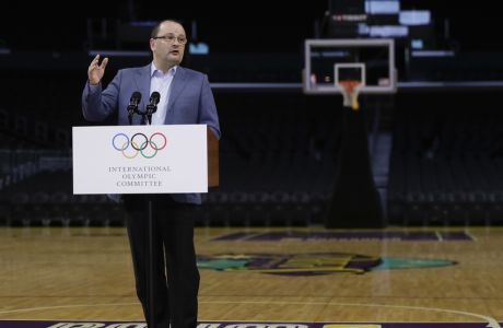 International Olympic Committee Evaluation Commission Chair Patrick Baumann speaks during a news conference at Staples Center, Friday, May 12, 2017, in Los Angeles. The IOC officials wrapped up four days of evaluating Los Angeles' bid for the 2024 Games before heading to Paris to check the only other candidate. (AP Photo/Jae C. Hong)