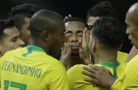 Brazil's Gabriel Jesus, center, celebrates wth his teammates after scoring his side's opening goal during the international friendly soccer match between Germany and Brazil in Berlin, Germany, Tuesday, March 27, 2018. (AP Photo/Michael Sohn)