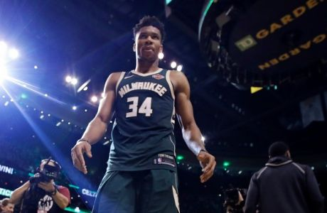 Milwaukee Bucks forward Giannis Antetokounmpo (34) walks off the court after the team's loss to the Boston Celtics in Game 7 of an NBA basketball first-round playoff series in Boston, Saturday, April 28, 2018. The Celtics won 112-96, eliminating the Bucks from the playoffs. (AP Photo/Charles Krupa)