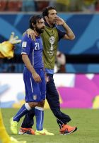 Italy's Andrea Pirlo, left, and goalkeeper Gianluigi Buffon, right, leave the pitch after the group D World Cup soccer match between England and Italy at the Arena da Amazonia in Manaus, Brazil, Saturday, June 14, 2014. Italy won the match 2-1.   (AP Photo/Matt Dunham)