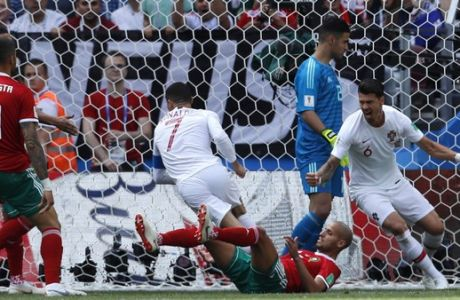 Portugal's Cristiano Ronaldo, center, celebrates after scoring the opening goal during the group B match between Portugal and Morocco at the 2018 soccer World Cup in the Luzhniki Stadium in Moscow, Russia, Wednesday, June 20, 2018. (AP Photo/Hassan Ammar)