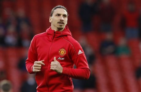Manchester United's Zlatan Ibrahimovic warms up before the English Premier League soccer match between Manchester United and Everton at Old Trafford in Manchester, England, Tuesday April 4, 2017. (Martin Rickett/PA via AP)