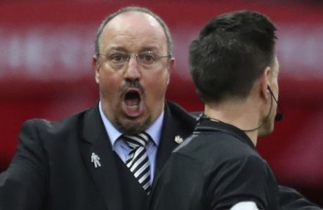 FILE - In this Saturday, Oct.6, 2018 file photo, Newcastle United's manager Rafael Benitez reacts to a decision by the referee during their English Premier League soccer match between Manchester United and Newcastle United at Old Trafford in Manchester, England. Keeping Newcastle in the Premier League for another year might be one of the greatest achievements in Benitezs coaching career. Newcastles has made its worst nine-game start to a league campaign since 1898. It has no wins in nine games, just two points, and five straight home losses. (AP Photo/Jon Super, File)