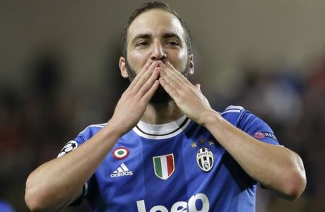 FILE - In this Wednesday, May 3, 2017 file photo, Juventus' Gonzalo Higuain celebrates after scoring during the Champions League semifinal first leg soccer match between Monaco and Juventus at the Louis II stadium in Monaco.  Juventus keeps on breaking records. And it set another one on Sunday when it clinched an unprecedented sixth successive Serie A title, with one game to spare, following a victory over Crotone. It is the first time since Serie A was founded in 1929 that a club has won six straight titles. (AP Photo/Claude Paris, File)