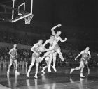 John Havlicek of Ohio State leaps to take a pass as Washington's Bill Hanson bears down behind him in the Los Angeles Basketball Classic Dec. 27, 1961. (AP Photo/Harold P. Matosian)