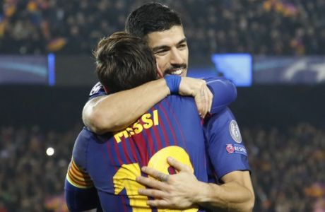 Barcelona's Luis Suarez hugs Barcelona's Lionel Messi who scored his side's third goal during the Champions League round of sixteen second leg soccer match between FC Barcelona and Chelsea at the Camp Nou stadium in Barcelona, Spain, Wednesday, March 14, 2018. (AP Photo/Emilio Morenatti)