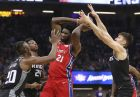 Philadelphia 76ers center Joel Embiid, center, is triple-teamed by Sacramento Kings' Harry Giles III, left, Buddy Hield and Bogdan Bogdanovic, right, during the first quarter of an NBA basketball game Saturday, Feb. 2, 2019, in Sacramento, Calif. (AP Photo/Rich Pedroncelli)