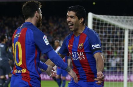 FC Barcelona's Luis Suarez, right, celebrates with his teammate Lionel Messi after scoring during the Spanish La Liga soccer match between FC Barcelona and Sevilla at the Camp Nou stadium in Barcelona, Spain, Wednesday, April 5, 2017. (AP Photo/Manu Fernandez)