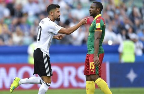 Germany's Kerem Demirbay celebrates past Cameroon's Sebastien Siani after scoring his side's first goal during the Confederations Cup, Group B soccer match between Germany and Cameroon, at the Fisht Stadium in Sochi, Russia, Sunday, June 25, 2017. (AP Photo/Martin Meissner)