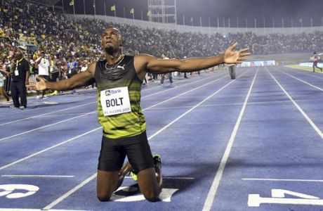 """Jamaica's Usain Bolt celebrates after winning the """"Salute to a Legend """" 100 meters during the Racers Grand Prix at the national stadium in Kingston, Jamaica, Saturday, June 10, 2017. Bolt started his final season with his last race on Jamaican soil and plans to retire from track and field after the 2017 London World Championships in August. (AP Photo/Bryan Cummings)"""