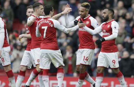 Arsenal's Pierre-Emerick Aubameyang, second right, celebrates after scoring his team's second goal during the English Premier League soccer match between Arsenal and Stoke City at the Emirates Stadium in London, Sunday, April 1, 2018. (AP Photo/Tim Ireland)