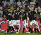 Argentina's Paulo Dybala, rigth, celebrates his side's second goal against Mexico during a friendly soccer match in Mendoza, Argentina, Tuesday, Nov. 20, 2018. (AP Photo/Gustavo Garello)