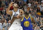 Utah Jazz center Rudy Gobert, left, and Golden State Warriors forward Draymond Green (23) battle for position under the basket in the second half during an NBA basketball game Friday, Oct. 19, 2018, in Salt Lake City. (AP Photo/Rick Bowmer)