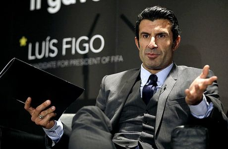 FILE - In this Thursday, Feb. 19, 2015 file photo, Luis Figo speaks to the media as he launches his FIFA Presidential Campaign manifesto, at Wembley Stadium, London. Sepp Blatters widely expected re-election on May 29 as president of soccers world governing body for a fifth term has seldom seemed a real contest. Three rival candidates entered the race in January: Prince Ali bin al-Hussein of Jordan, Luis Figo of Portugal and Michael van Praag of the Netherlands. Van Praag, however, dropped out of the race on Thursday May 21, 2015, and switched his support to FIFA vice president Prince Ali. (AP Photo/Matt Dunham, File)