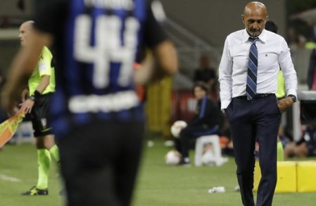 Inter Milan coach Luciano Spalletti walks on the pitch during a Serie A soccer match between Inter Milan and Torino, at the San Siro stadium in Milan, Italy, Sunday, Aug. 26, 2018. (AP Photo/Luca Bruno)
