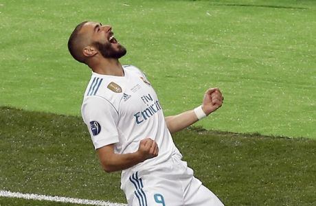 Real Madrid's Karim Benzema celebrates after scoring the opening goal during the Champions League Final soccer match between Real Madrid and Liverpool at the Olimpiyskiy Stadium in Kiev, Ukraine, Saturday, May 26, 2018. (AP Photo/Darko Vojinovic)