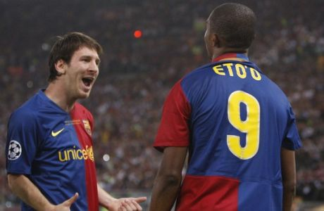 Barcelona's Samuel Eto'o, right, celebrates with his teammate Lionel Messi after scoring, during the UEFA Champions League final soccer match between Manchester United and Barcelona in Rome, Wednesday May 27, 2009. (AP Photo/Jon Super)