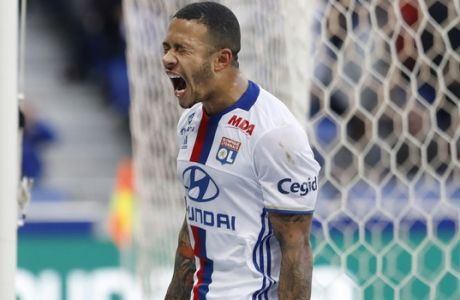 Lyon's Memphis Depay reacts after missing a goal during their French League One soccer match against Dijon in Decines, near Lyon, central France, Sunday, Feb. 19, 2017. (AP Photo/Laurent Cipriani)