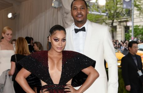 "La La Anthony, left, and Carmelo Anthony arrive at The Metropolitan Museum of Art Costume Institute Benefit Gala, celebrating the opening of ""Manus x Machina: Fashion in an Age of Technology"" on Monday, May 2, 2016, in New York. (Photo by Evan Agostini/Invision/AP)"