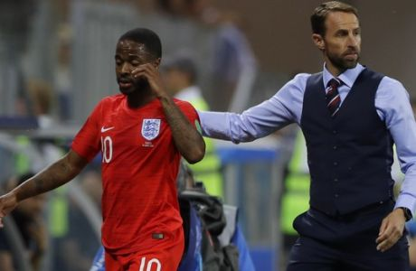 England head coach Gareth Southgate escorts Raheem Sterling after he replaced him by Marcus Rashford during the group G match between Tunisia and England at the 2018 soccer World Cup in the Volgograd Arena in Volgograd, Russia, Monday, June 18, 2018. (AP Photo/Alastair Grant)