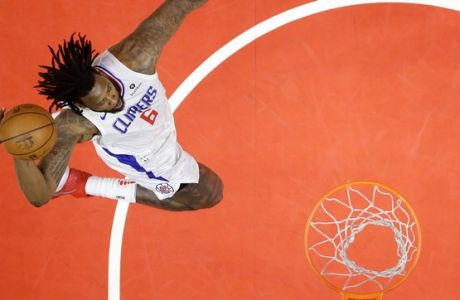 Los Angeles Clippers center DeAndre Jordan goes up for a dunk during the first half of an NBA basketball game against the New Orleans Pelicans, Monday, April 9, 2018, in Los Angeles. (AP Photo/Mark J. Terrill)