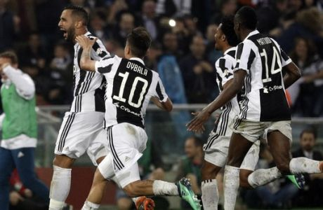 Juventus' Medhi Benatia, left, celebrates after scoring during the Italian Cup final soccer match between Juventus and AC Milan, at the Rome Olympic stadium, Wednesday, May 9, 2018. (AP Photo/Gregorio Borgia)