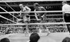 Boxers Alfonso Frazer of Panama, right, and Nicolino Locche of Argentina are shown in action during their bout in Panama City, March 11, 1972. (AP Photo)
