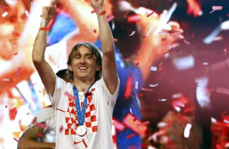 Croatia's player Luka Modric celebrates upon arrival in Zagreb, Croatia, Monday, July 16, 2018. Euphoria gave way to a mixture of disappointment and pride for Croatia fans after their national team lost to France in its first ever World Cup final. (AP Photo/Darko Vojinovic)