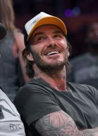 Former soccer player David Beckham watches during the first half of an NBA basketball game between the Los Angeles Lakers and the Memphis Grizzlies, Sunday, April 2, 2017, in Los Angeles. (AP Photo/Mark J. Terrill)