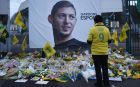 "FILE - In this Wednesday, Jan. 30, 2019, file photo, a Nantes soccer team supporters stops by a poster of Argentinian player Emiliano Sala and reading ""Let's keep hope"" outside La Beaujoire stadium before the French soccer League One match Nantes against Saint-Etienne, in Nantes, western France. On Sunday, Feb. 3, 2019, the man leading a private search for the missing plane carrying Argentine soccer player Emiliano Sala says the wreckage has been found. (AP Photo/Thibault Camus, File)"