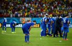 RECIFE, BRAZIL - JUNE 29: Greece players show their dejection after the defeat in the 2014 FIFA World Cup Brazil Round of 16 match between Costa Rica and Greece at Arena Pernambuco on June 29, 2014 in Recife, Brazil.  (Photo by Alex Grimm - FIFA/FIFA via Getty Images)