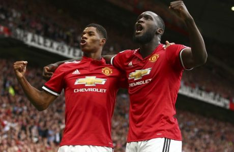 Manchester United's Romelu Lukaku, right, celebrates with Manchester United's Marcus Rashford after scoring his side's first goal of the game during the English Premier League soccer match between Manchester United and West Ham United at Old Trafford in Manchester, England, Sunday, Aug. 13, 2017. (AP Photo/Dave Thompson)