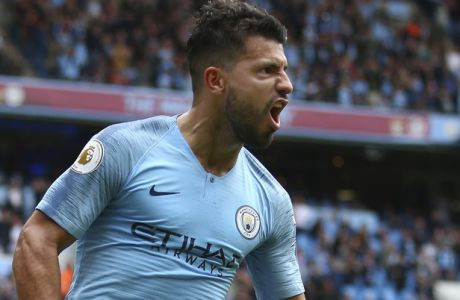 Manchester City's Sergio Aguero celebrates scoring his side's third goal of the game during the English Premier League soccer match between Manchester City and Huddersfield Town at the Etihad Stadium in Manchester, England, Sunday, Aug. 19, 2018. (AP Photo/Dave Thompson)