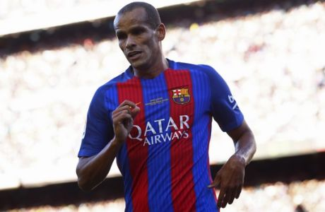 Former FC Barcelona player Rivaldo runs during a friendly soccer match between FC Barcelona legends and Manchester United legends at the Camp Nou stadium in Barcelona, Spain, Friday, June, 30, 2017. (AP Photo/Manu Fernandez)