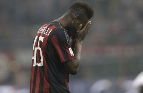 AC Milan's Mario Balotelli rests during a Serie A soccer match between AC Milan and Juventus, at the San Siro stadium in Milan, Italy, Saturday, April 9, 2016. (AP Photo/Luca Bruno)