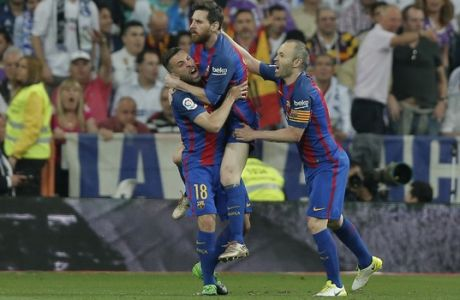 Barcelona's Lionel Messi, center, celebrates with Jordi Alba and Andres Iniesta, right after scoring his side's 1st goal during a Spanish La Liga soccer match between Real Madrid and Barcelona, dubbed 'el clasico', at the Santiago Bernabeu stadium in Madrid, Spain, Sunday, April 23, 2017. (AP Photo/Daniel Ochoa de Olza)