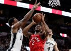 Toronto Raptors forward Kawhi Leonard (2) is blocked as he drives to the basket against San Antonio Spurs guard DeMar DeRozan (10) and guard Derrick White (4) during the first half of an NBA basketball game, Thursday, Jan. 3, 2019, in San Antonio. (AP Photo/Eric Gay)